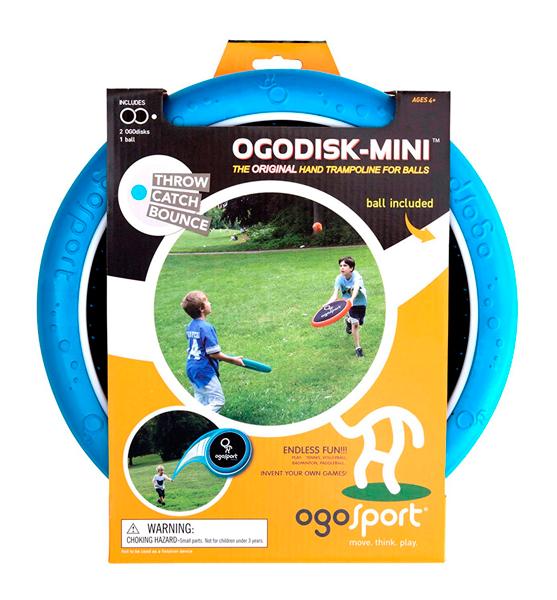 """DE 3AÑOS A MÁS  El tamaño pequeño del ogodisk mini incrementa la dificultad de precisión del juego.  Contenido:  •02 discos trampolines de 12"""" en color azul y naranja.  •01 pelota OgoSoft.  Materiales:  •Gomaeva, Nylon-spandex."""