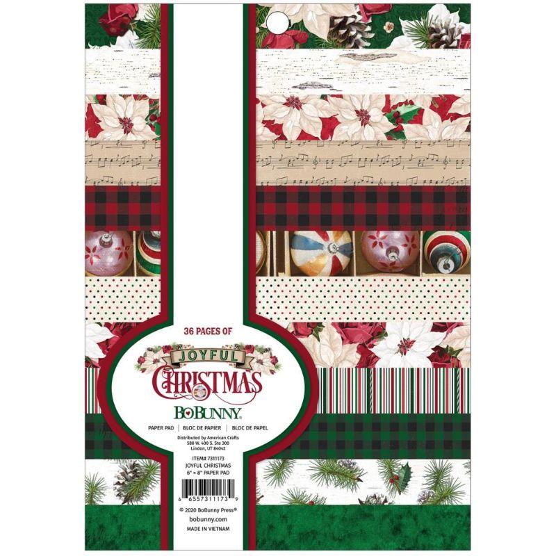 """Block de Papel con Diseños """"Joyful Christmas""""  Capture toda su imaginacion sobre la temporada navideña con el block de papel Joyful Christmas Collection de 6 """"x 8"""" de BoBunny. En el block de papel se incluyen 36 hojas de papel con patrones de acebo, adornos, flor de pascua, partituras, piñas y más.  Equipo Scrapyart"""