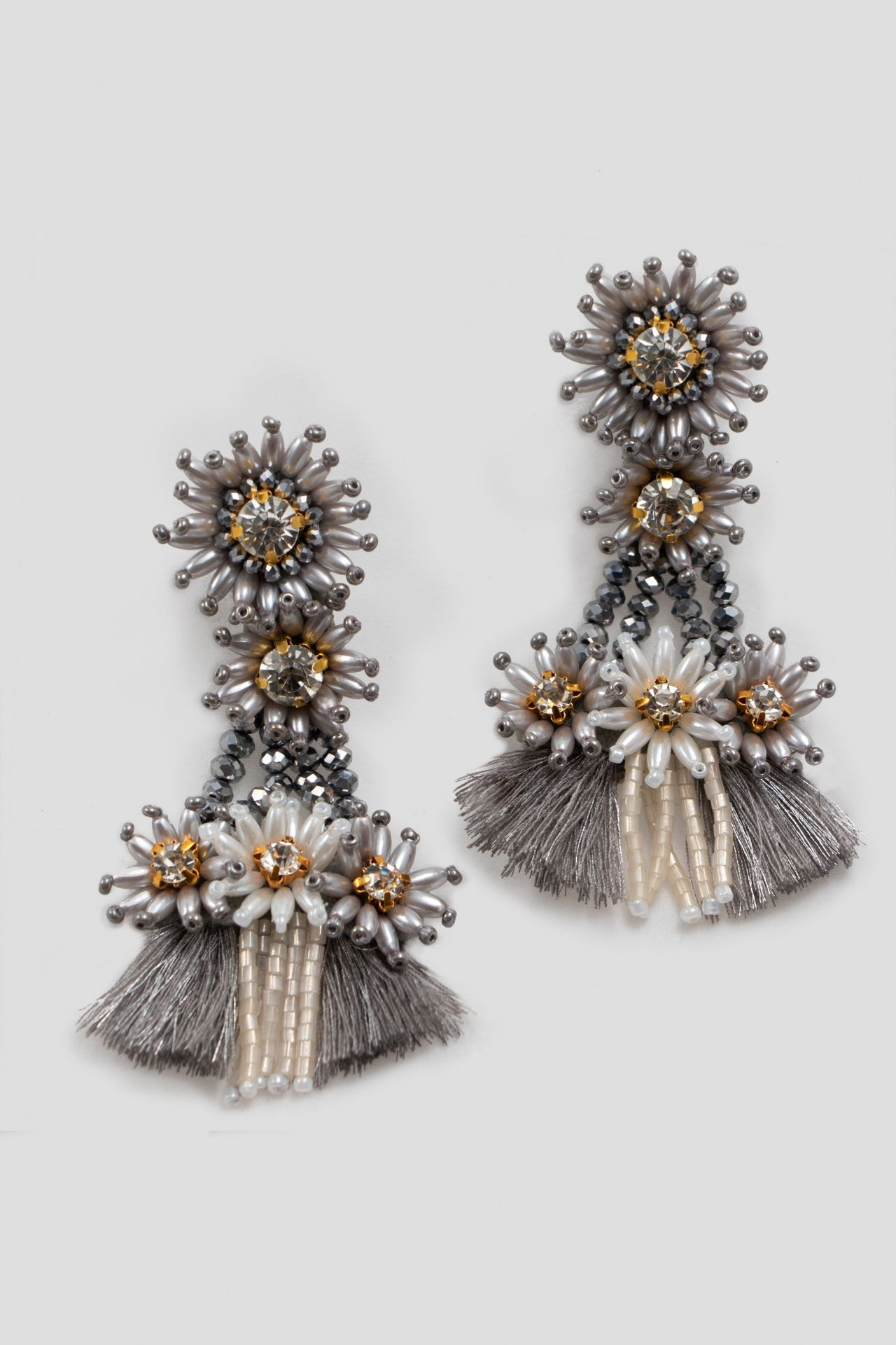 Maxiaretes hechos a mano con mostacillas y muranos.  Cosidos a mano piedra por piedra.  Alto: 9cm  Ancho: 4.5 cm