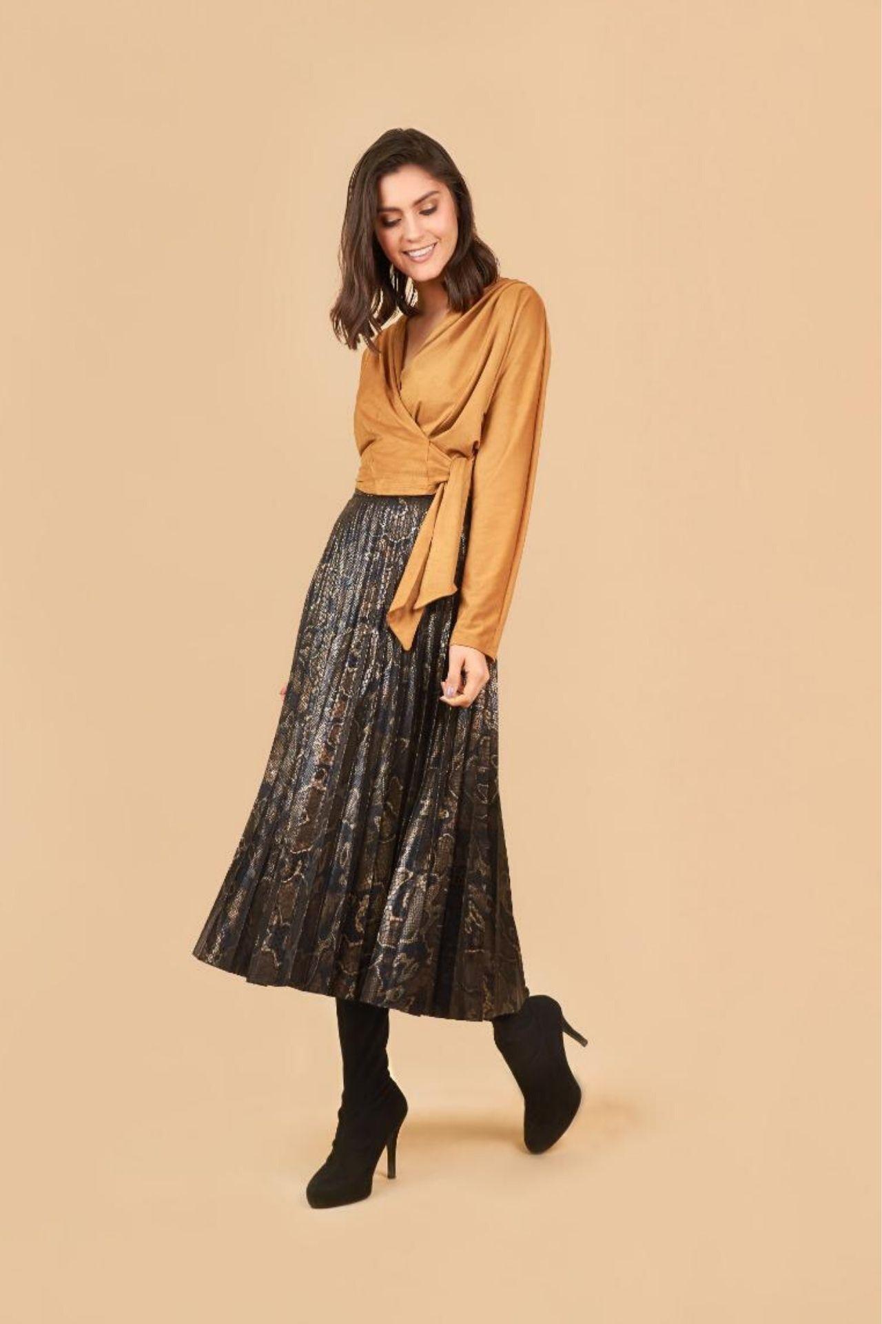 Falda London está elaborado de Latex texturado.  Esta prenda es elegante, ideal para toda ocasión