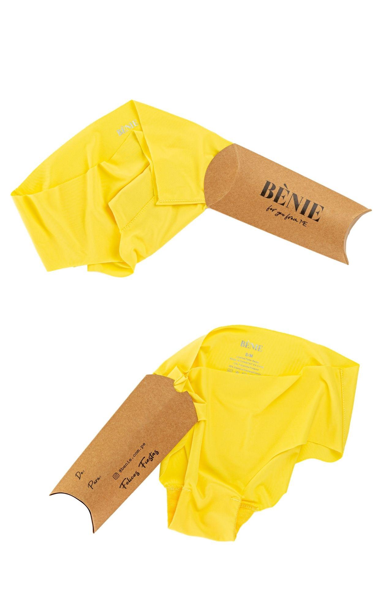 Empieza el 2021 libre, sin costuras, alegre, optimista y llena de energía con los calzones invisibles amarillos Bènie. Cuentan con una protección de algodón en la zona íntima para la máxima comodidad y seguridad. Presentación: Cajitas de regalo individual  Medidas:  Cadera  77-87 cm  88-98 cm